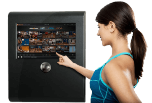 Woman Selecting Workout Program from Fitness on Demand